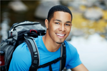 Young guy happy backpacking